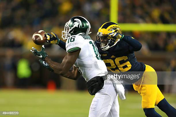 Aaron Burbridge of the Michigan State Spartans makes a catch in the fourth quarter against Jourdan Lewis of the Michigan Wolverines at Michigan...
