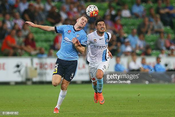 Aaron Calver of Sydney FC and Bruno Fornaroli of Melbourne City compete for the ball during the round 22 ALeague match between Melbourne City FC and...