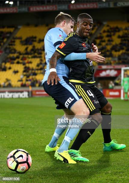 Aaron Calver of Sydney FC and Roly Bonevacia of the Phoenix compete for the ball during the round 26 ALeague match between the Wellington Phoenix and...