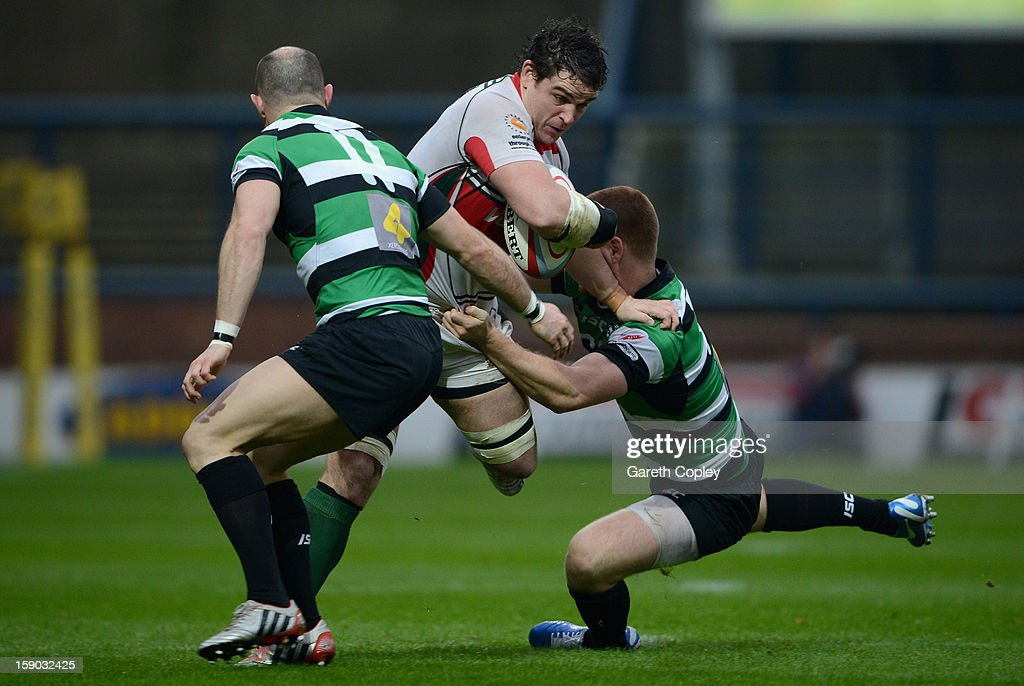 Aaron Carpenter of Plymouth is tackled by David Doherty and Rory Clegg of Leeds during the RFU Championship match between Leeds Carnegie and Plymouth Albion at Headingley Carnegie Stadium on January 6, 2013 in Leeds, England.