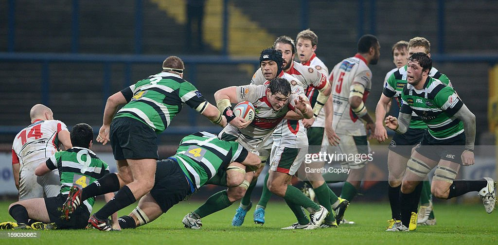 Aaron Carpenter of Plymouth is tackled by Jacob Rown of Leeds during the RFU Championship match between Leeds Carnegie and Plymouth Albion at Headingley Carnegie Stadium on January 6, 2013 in Leeds, England.