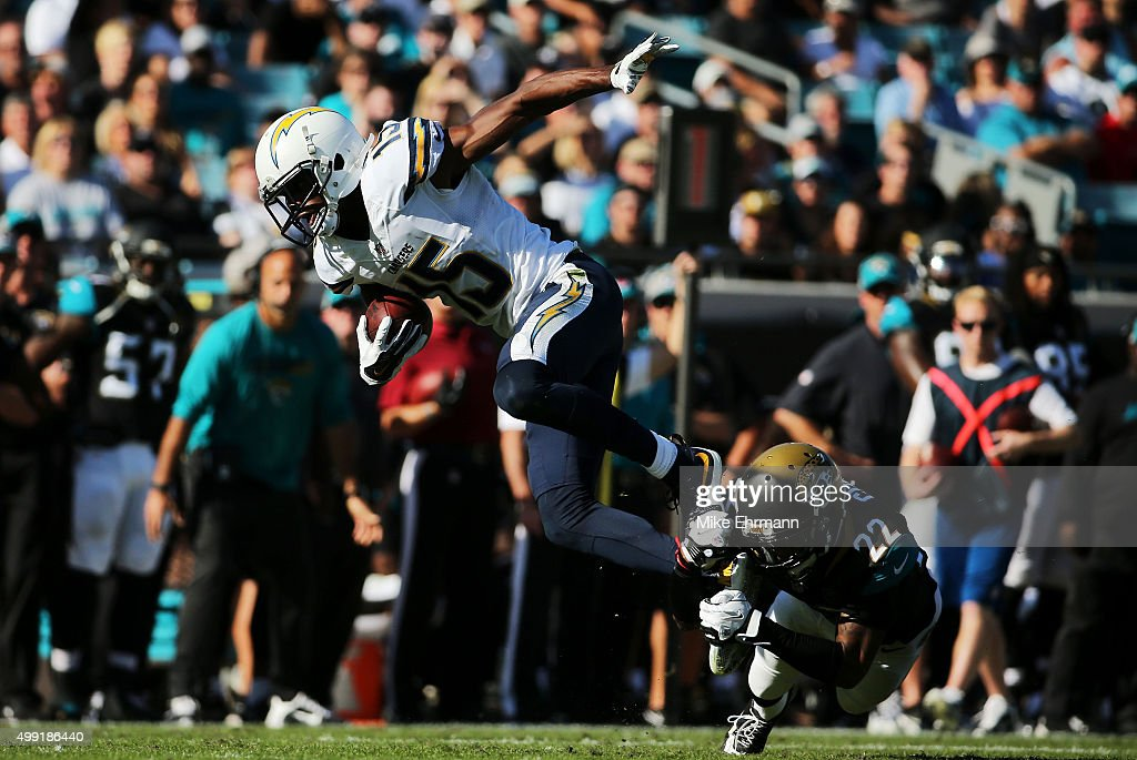 Aaron Colvin of the Jacksonville Jaguars tackles Dontrelle Inman of the San Diego Chargers in the second quarter at EverBank Field on November 29...