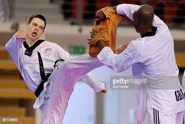 Aaron Cook in action against his sparring partner Mamedy Doucara during Team GB Taekwondo training at the Macau pavilion on July 31 2008 in Macau...
