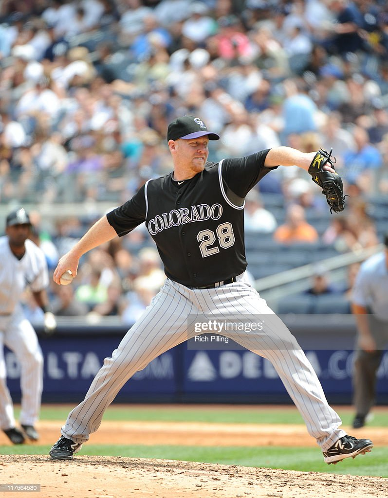 Aaron Cook of the Colorado Rockies pitches during the game against the New York Yankees on June 25 2011 at Yankee Stadium in the Bronx borough of New...