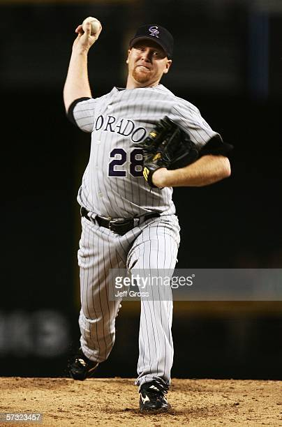 Aaron Cook of the Colorado Rockies throws a pitch during the game against the Arizona Diamondbacks on April 11 2006 at Chase Field in Phoenix Arizona