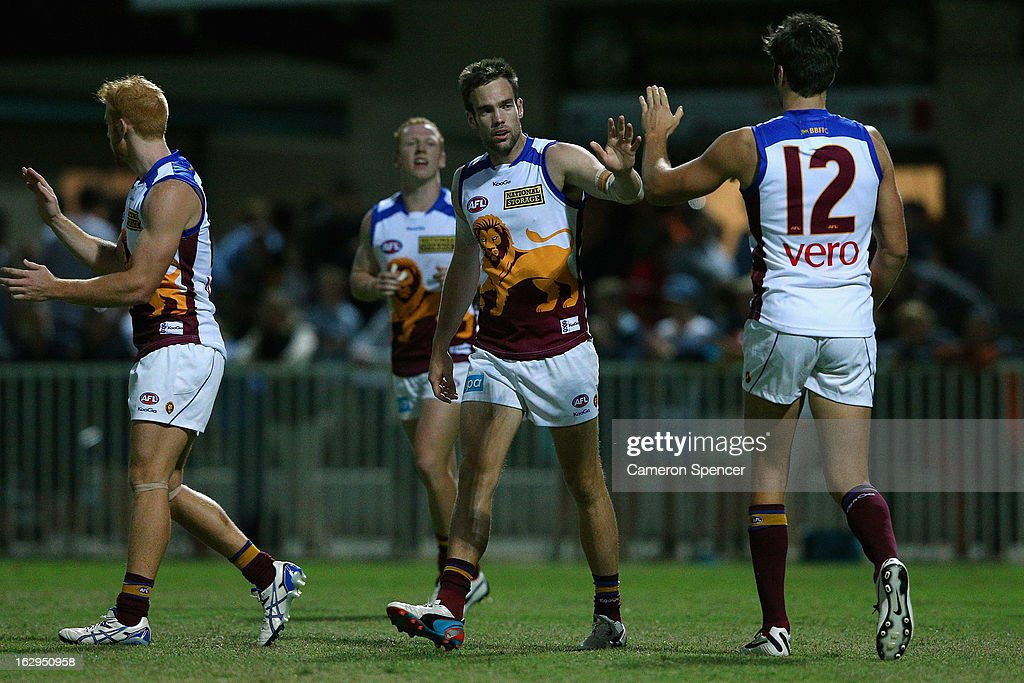 Aaron Cornelius of the Lions celebrates a goal with team mates during the round two AFL NAB Cup match between the Greater Western Sydney Giants and the Brisbane Lions at the Robertson Oval in Wagga Wagga, Australia.