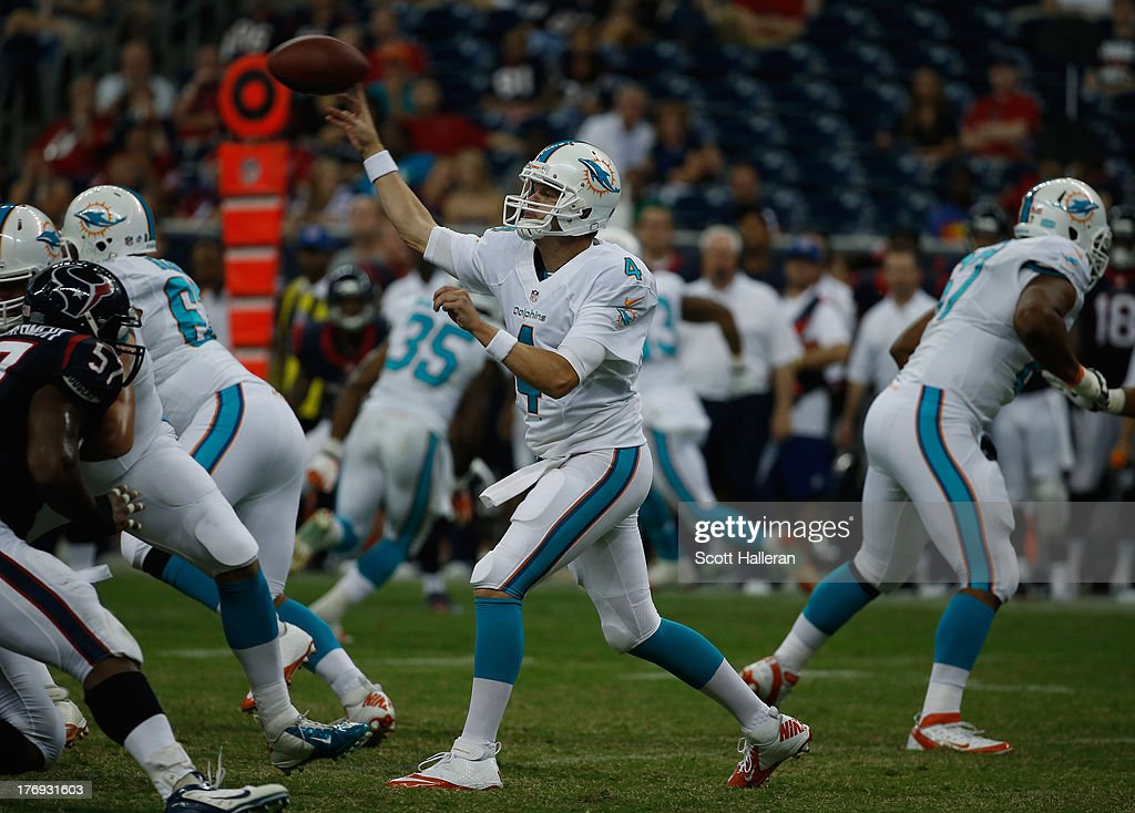 <a gi-track='captionPersonalityLinkClicked' href=/galleries/search?phrase=Aaron+Corp&family=editorial&specificpeople=4195458 ng-click='$event.stopPropagation()'>Aaron Corp</a> #4 of the Miami Dolphins drops back to pass against the Houston Texans during a preseaon game at Reliant Stadium on August 17, 2013 in Houston, Texas.