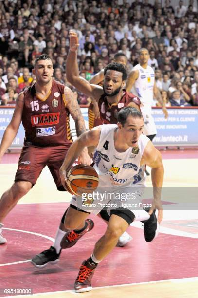 Aaron Craft of Dolomiti competes with Esteban Batista and MarQuez Haynes of Umana during the match game 1 of play off final series of LBA Legabasket...