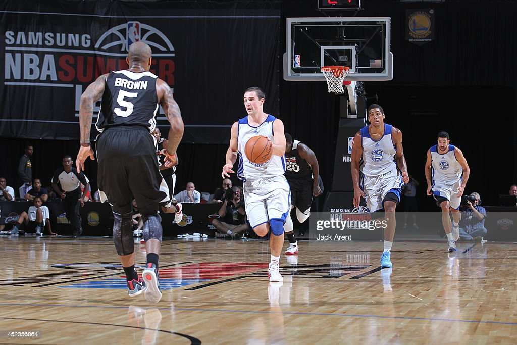 Aaron Craft #4 of the Golden State Warriors moves the ball up-court against the Milwaukee Bucks at the Samsung NBA Summer League 2014 on July 18, 2014 at the Thomas & Mack Center in Las Vegas, Nevada.