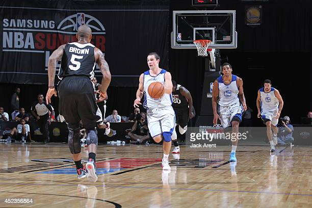 Aaron Craft of the Golden State Warriors moves the ball upcourt against the Milwaukee Bucks at the Samsung NBA Summer League 2014 on July 18 2014 at...