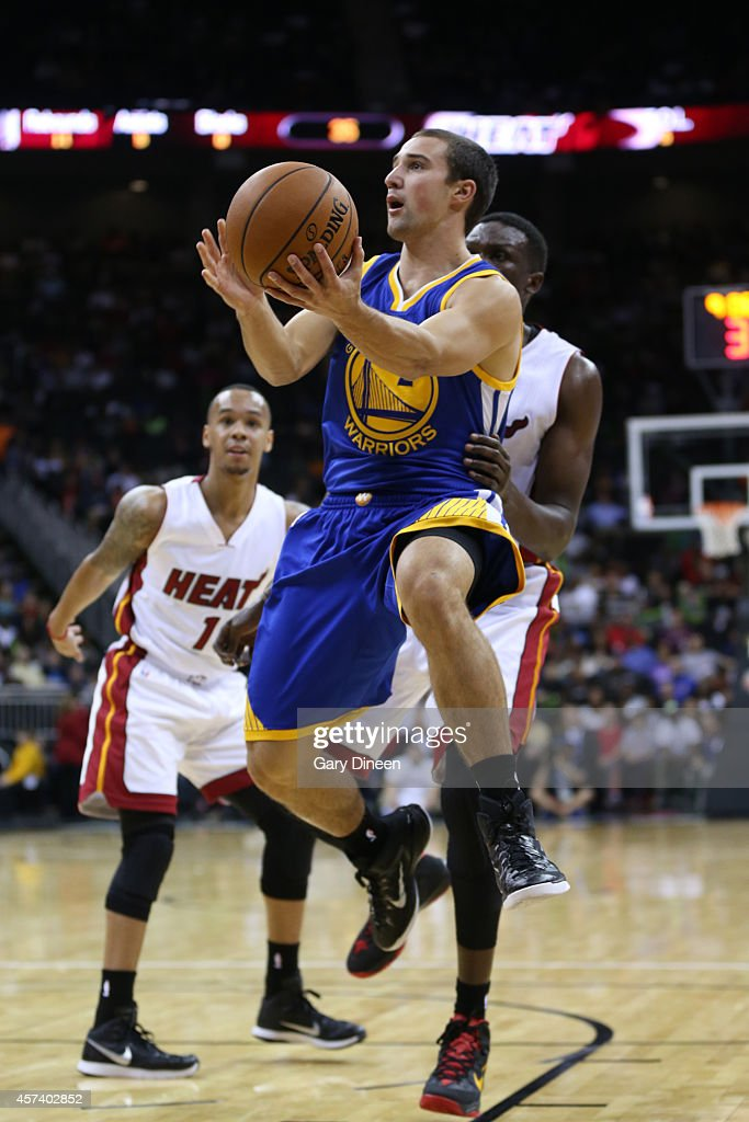 <a gi-track='captionPersonalityLinkClicked' href=/galleries/search?phrase=Aaron+Craft&family=editorial&specificpeople=7348782 ng-click='$event.stopPropagation()'>Aaron Craft</a> #2 of the Golden State Warriors takes a layup against the Miami Heat during a game on October 17, 2014 at Sprint Center in Kansas City, Missouri.