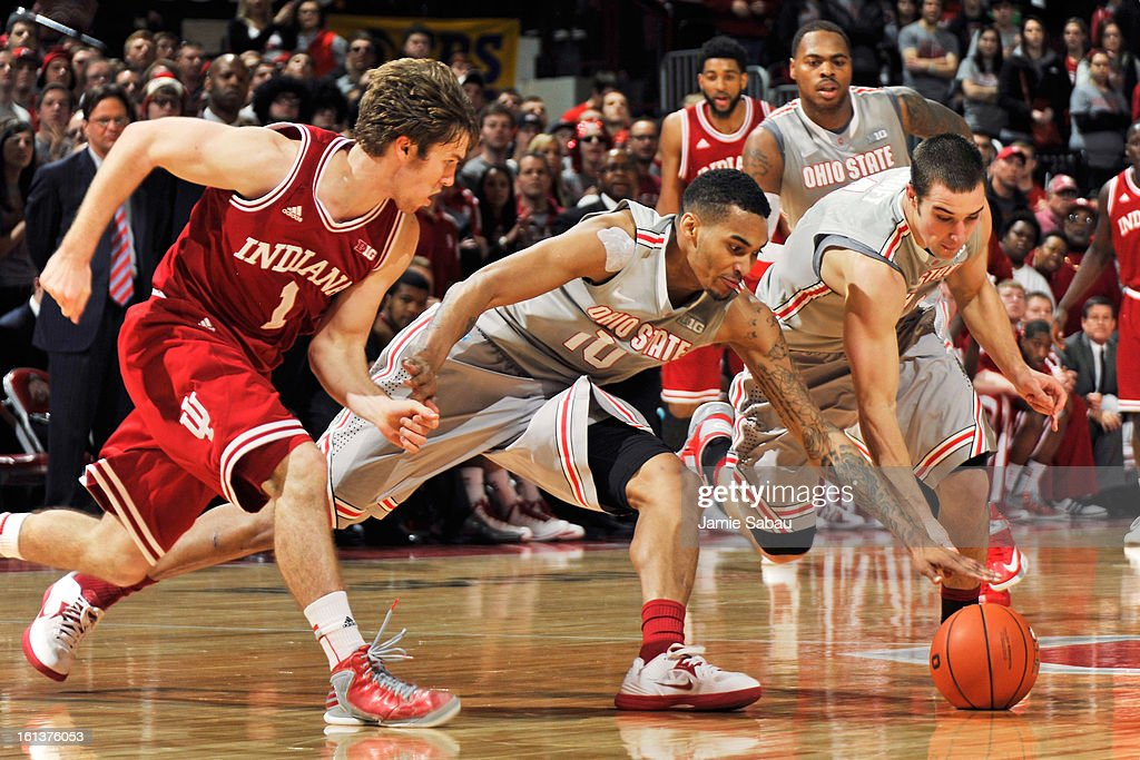 <a gi-track='captionPersonalityLinkClicked' href=/galleries/search?phrase=Aaron+Craft&family=editorial&specificpeople=7348782 ng-click='$event.stopPropagation()'>Aaron Craft</a> #4 of the Ohio State Buckeyes and LaQuinton Ross #10 of the Ohio State Buckeyes scramble to gain control of the ball after forcing a turnover from Jordan Hulls #1 of the Indiana Hoosiers in the second half on February 10, 2013 at Value City Arena in Columbus, Ohio. Indiana defeated Ohio State 81-68.