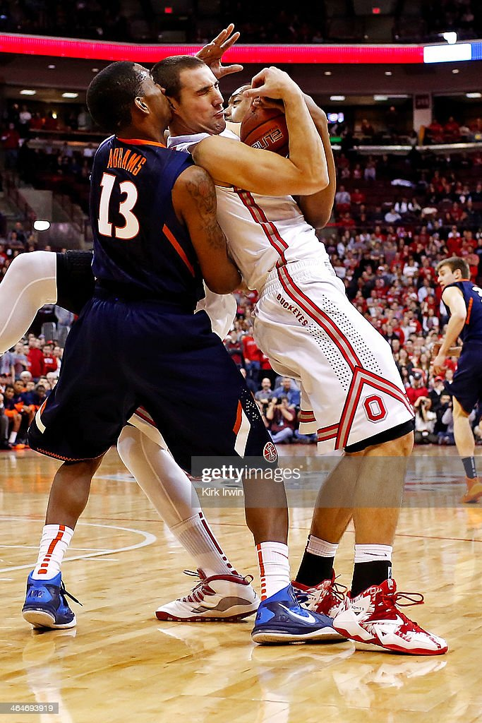 Aaron Craft of the Ohio State Buckeyes and Tracy Abrams of the Illinios Fighting Illini battle for control of the ball during the first half at Value...
