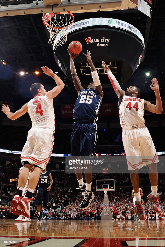 Aaron Craft of the Ohio State Buckeyes and William Buford of the Ohio State Buckeyes defend as Jon Graham of the Penn State Nittany Lions puts up a...