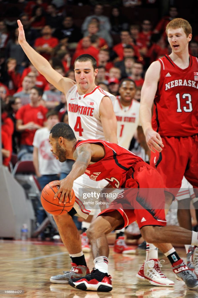 <a gi-track='captionPersonalityLinkClicked' href=/galleries/search?phrase=Aaron+Craft&family=editorial&specificpeople=7348782 ng-click='$event.stopPropagation()'>Aaron Craft</a> #4 of the Ohio State Buckeyes applies defensive pressure to Ray Gallegos #15 of the Nebraska Cornhuskers in the second half on January 2, 2013 at Value City Arena in Columbus, Ohio. Ohio State defeated Nebraska 70-44.