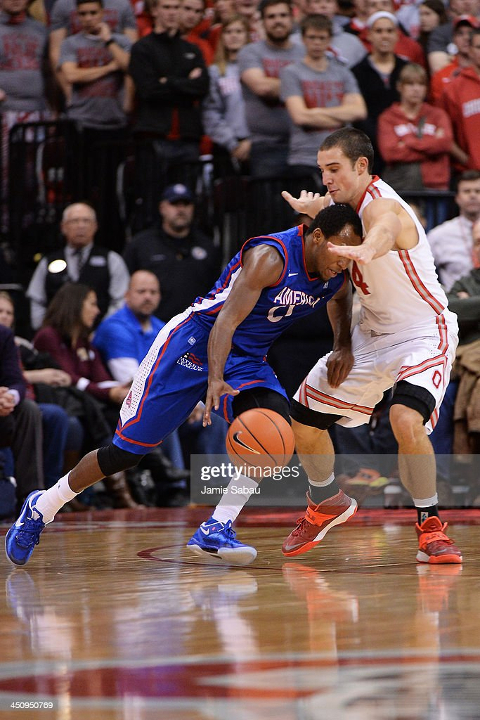 <a gi-track='captionPersonalityLinkClicked' href=/galleries/search?phrase=Aaron+Craft&family=editorial&specificpeople=7348782 ng-click='$event.stopPropagation()'>Aaron Craft</a> #4 of the Ohio State Buckeyes applies defensive pressure to Darius Gardner #0 of the American University Eagles in the second half on November 20, 2013 at Value City Arena in Columbus, Ohio. Ohio State defeated American 63-52.
