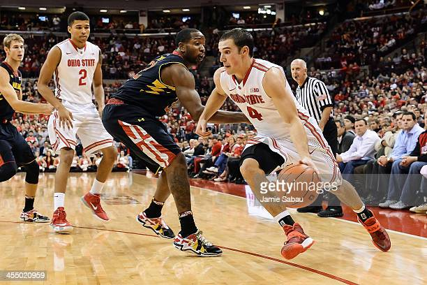 Aaron Craft of the Ohio State Buckeyes controls the ball against the Maryland Terrapins on December 4 2013 at Value City Arena in Columbus Ohio Ohio...
