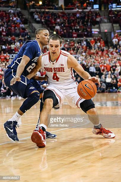 Aaron Craft of the Ohio State Buckeyes controls the ball against the Penn State Nittany Lions on January 29 2014 at Value City Arena in Columbus Ohio
