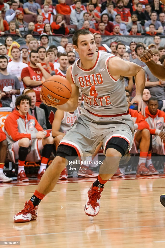 <a gi-track='captionPersonalityLinkClicked' href=/galleries/search?phrase=Aaron+Craft&family=editorial&specificpeople=7348782 ng-click='$event.stopPropagation()'>Aaron Craft</a> #4 of the Ohio State Buckeyes controls the ball against the Michigan Wolverines on February 11, 2014 at Value City Arena in Columbus, Ohio.