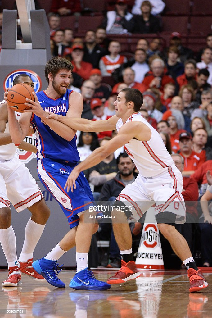 <a gi-track='captionPersonalityLinkClicked' href=/galleries/search?phrase=Aaron+Craft&family=editorial&specificpeople=7348782 ng-click='$event.stopPropagation()'>Aaron Craft</a> #4 of the Ohio State Buckeyes defends against Tony Wroblicky #34 of the American University Eagles in the first half on November 20, 2013 at Value City Arena in Columbus, Ohio. Ohio State defeated American 63-52.