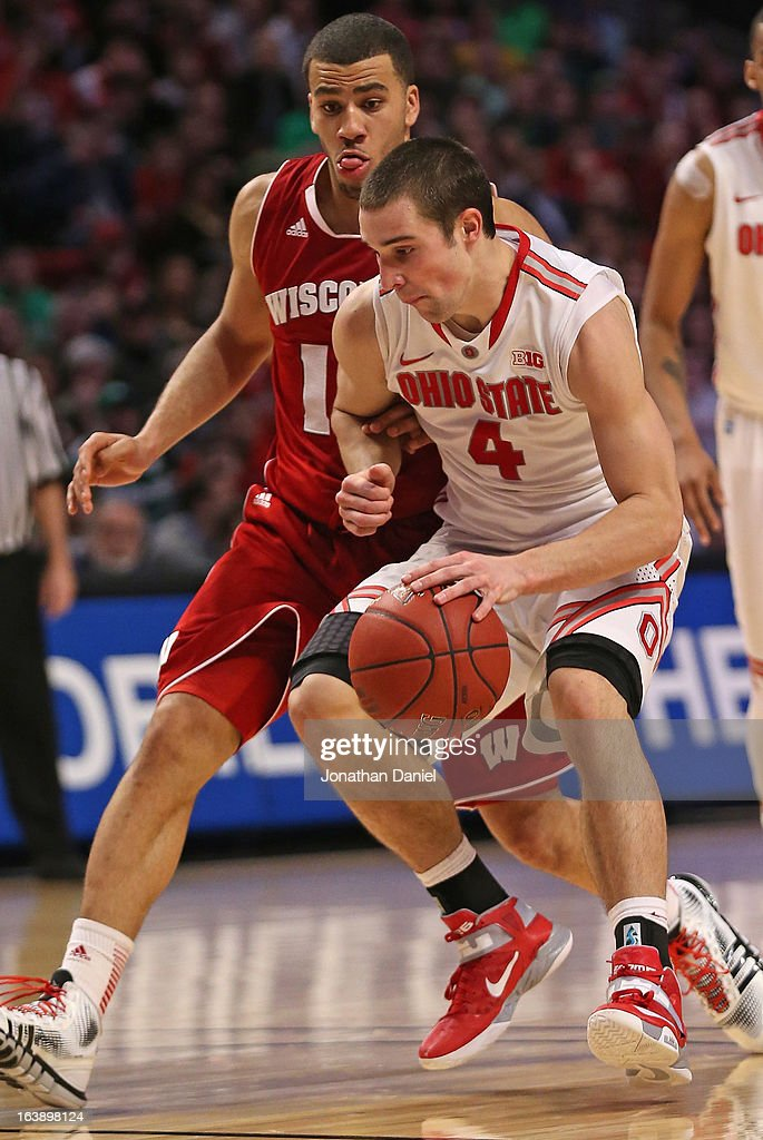 Aaron Craft #4 of the Ohio State Buckeyes dribbles against Traevon Jackson #12 of the Wisconsin Badgers during the Big Ten Basketball Tournament Championship game at United Center on March 17, 2013 in Chicago, Illinois. Ohio State defeats Wisconsin 50-43.