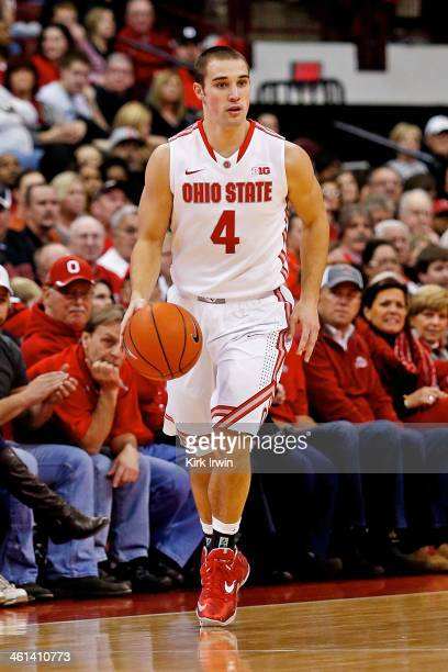 Aaron Craft of the Ohio State Buckeyes dribbles the ball during the game against the LouisianaMonroe Warhawks at Value City Arena on December 27 2013...