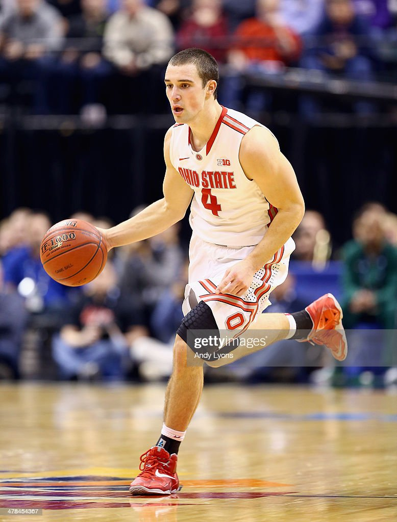 <a gi-track='captionPersonalityLinkClicked' href=/galleries/search?phrase=Aaron+Craft&family=editorial&specificpeople=7348782 ng-click='$event.stopPropagation()'>Aaron Craft</a> #4 of the Ohio State Buckeyes dribbles the ball in the game against the Purdue Boilermakes during the first round of the Big Ten Basketball Tournament at Bankers Life Fieldhouse on March 13, 2014 in Indianapolis, Indiana.