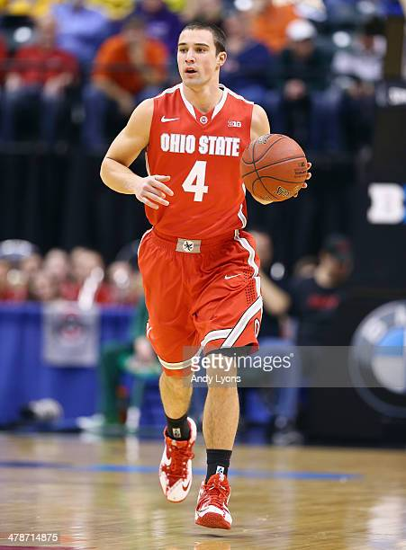 Aaron Craft of the Ohio State Buckeyes dribbles the ball in the game against the Nebraska Cornhuskers during the Quarterfinals of the Big Ten...