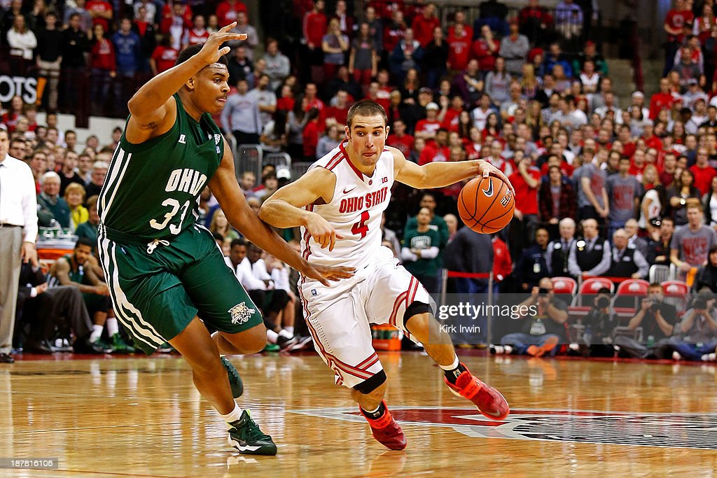 <a gi-track='captionPersonalityLinkClicked' href=/galleries/search?phrase=Aaron+Craft&family=editorial&specificpeople=7348782 ng-click='$event.stopPropagation()'>Aaron Craft</a> #4 of the Ohio State Buckeyes drives against Antonio Campbell #3 of the Ohio Bobcats during the second half at Value City Arena on November 12, 2013 in Columbus, Ohio. Ohio State defeated Ohio 79-69.