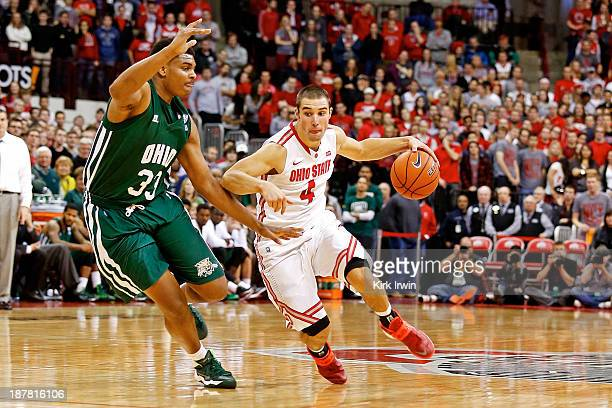 Aaron Craft of the Ohio State Buckeyes drives against Antonio Campbell of the Ohio Bobcats during the second half at Value City Arena on November 12...