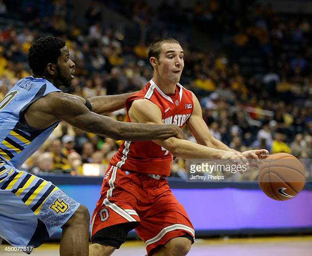 Aaron Craft of the Ohio State Buckeyes drives against Jamil Wilson of the Marquette Golden Eagles during a basketball game at BMO Harris Bradley...