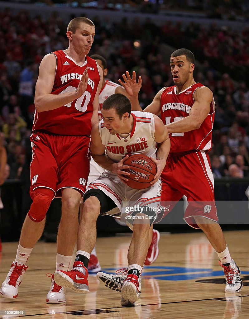 <a gi-track='captionPersonalityLinkClicked' href=/galleries/search?phrase=Aaron+Craft&family=editorial&specificpeople=7348782 ng-click='$event.stopPropagation()'>Aaron Craft</a> #4 of the Ohio State Buckeyes drives against Jared Bergrren #40 and Traevon Jackson #12 of the Wisconsin Badgers during the Big Ten Basketball Tournament Championship game at United Center on March 17, 2013 in Chicago, Illinois. Ohio State defeated Wisconsin 50-43.