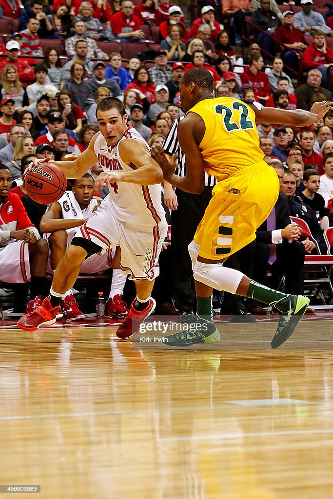 <a gi-track='captionPersonalityLinkClicked' href=/galleries/search?phrase=Aaron+Craft&family=editorial&specificpeople=7348782 ng-click='$event.stopPropagation()'>Aaron Craft</a> #4 of the Ohio State Buckeyes drives against Kory Brown #22 of the North Dakota State Bison during the second half at Value City Arena on December 14, 2013 in Columbus, Ohio. Ohio State defeated North Dakota State 79-62.