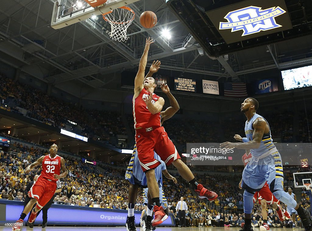 <a gi-track='captionPersonalityLinkClicked' href=/galleries/search?phrase=Aaron+Craft&family=editorial&specificpeople=7348782 ng-click='$event.stopPropagation()'>Aaron Craft</a> #4 of the Ohio State Buckeyes drives against Todd Mayo #4 of the Marquette Golden Eagles during a basketball game at BMO Harris Bradley Center on November 16, 2013 in Milwaukee, Wisconsin.
