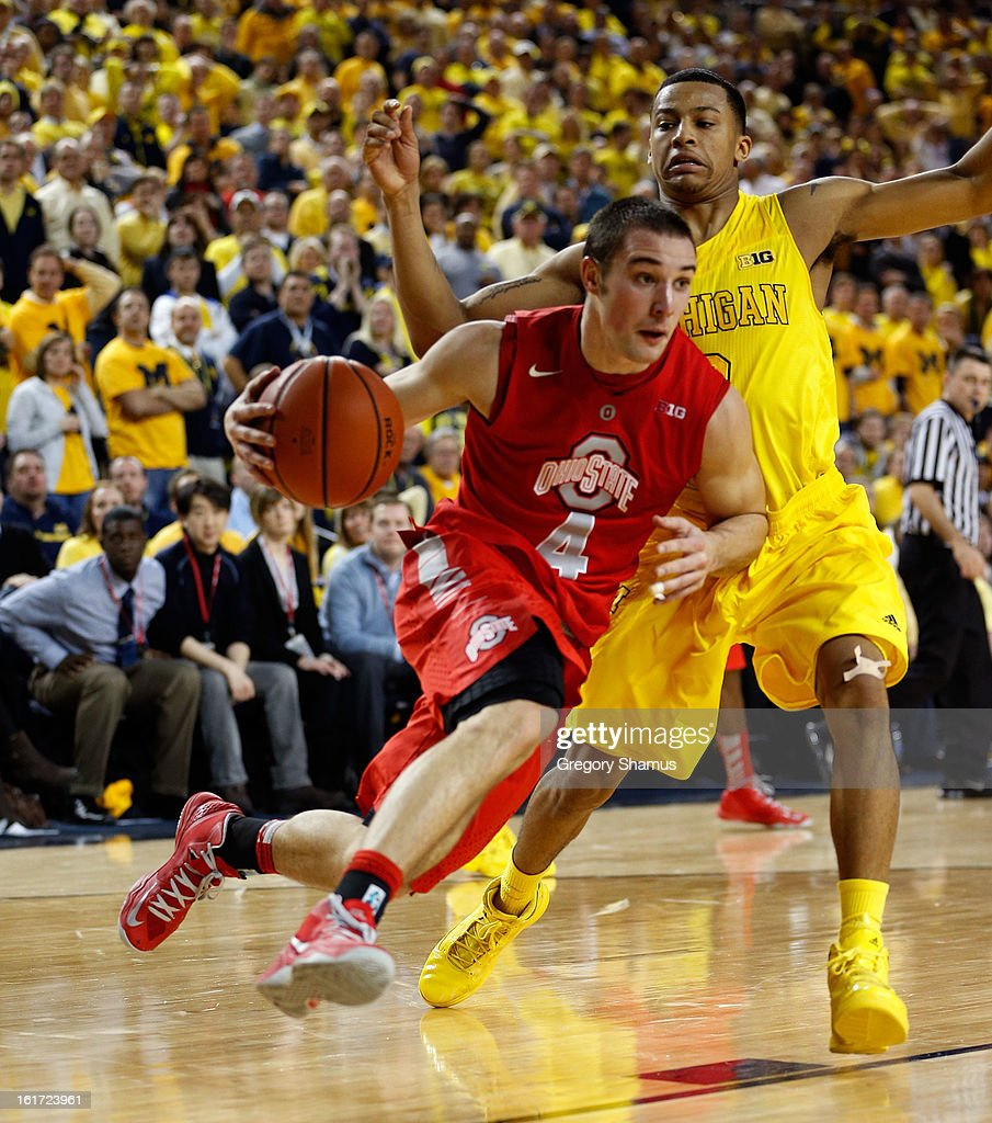 Aaron Craft #4 of the Ohio State Buckeyes drives past Trey Burke #3 of the Michigan Wolverines at Crisler Center on February 5, 2013 in Ann Arbor, Michigan. Michigan won the game 76-74 in overtime.