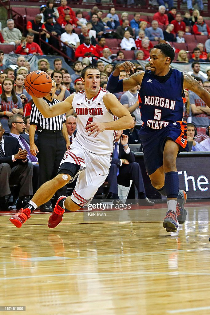 <a gi-track='captionPersonalityLinkClicked' href=/galleries/search?phrase=Aaron+Craft&family=editorial&specificpeople=7348782 ng-click='$event.stopPropagation()'>Aaron Craft</a> #4 of the Ohio State Buckeyes drives the ball past Justin Black #5 of the Morgan State Bears at Value City Arena on November 9, 2013 in Columbus, Ohio. Ohio State defeated Morgan State 89-50.