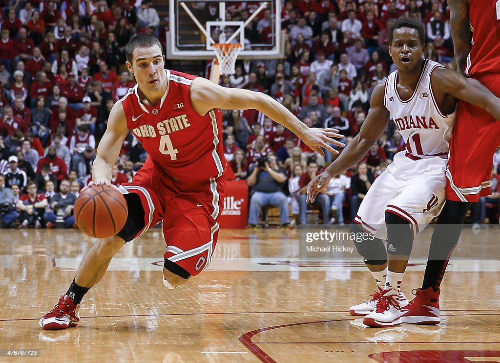 <a gi-track='captionPersonalityLinkClicked' href=/galleries/search?phrase=Aaron+Craft&family=editorial&specificpeople=7348782 ng-click='$event.stopPropagation()'>Aaron Craft</a> #4 of the Ohio State Buckeyes drives to the basket during the game against the Indiana Hoosiers at Assembly Hall on March 2, 2014 in Bloomington, Indiana. Indiana defeated Ohio State 72-64.