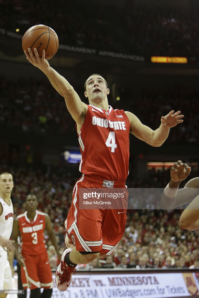 <a gi-track='captionPersonalityLinkClicked' href=/galleries/search?phrase=Aaron+Craft&family=editorial&specificpeople=7348782 ng-click='$event.stopPropagation()'>Aaron Craft</a> #4 of the Ohio State Buckeyes drives to the hoop during the game against the Wisconsin Badgers at Kohl Center on February 01, 2014 in Madison, Wisconsin.