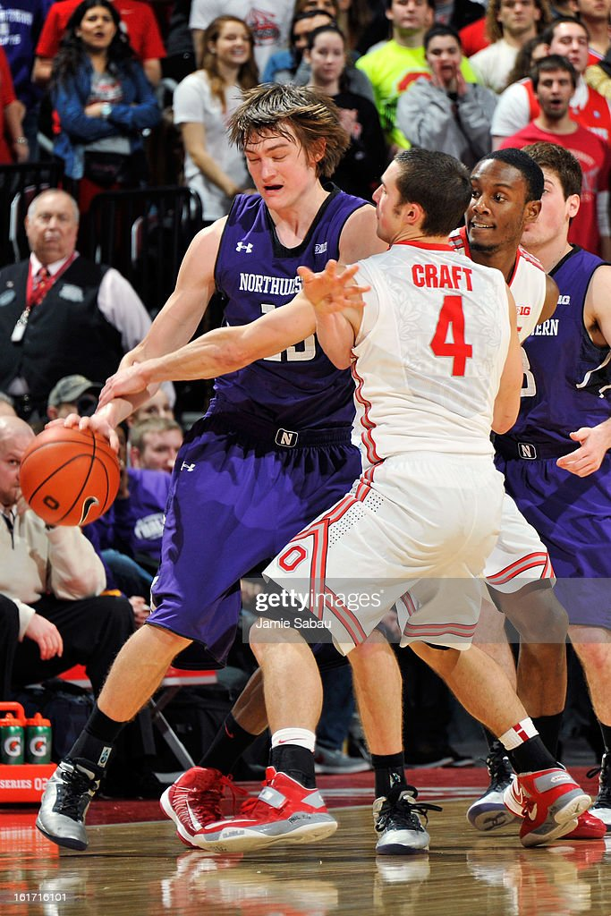 <a gi-track='captionPersonalityLinkClicked' href=/galleries/search?phrase=Aaron+Craft&family=editorial&specificpeople=7348782 ng-click='$event.stopPropagation()'>Aaron Craft</a> #4 of the Ohio State Buckeyes fouls Kale Abrahamson #13 of the Northwestern Wildcats while guarding him in the second half on February 14, 2013 at Value City Arena in Columbus, Ohio. Ohio State defeated Northwestern 69-59.