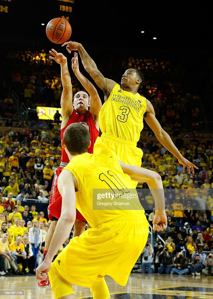 Aaron Craft #4 of the Ohio State Buckeyes gets his shot blocked in overtime by Trey Burke #3 of the Michigan Wolverines at Crisler Center on February 5, 2013 in Ann Arbor, Michigan. Michigan won the game 76-74 in overtime.