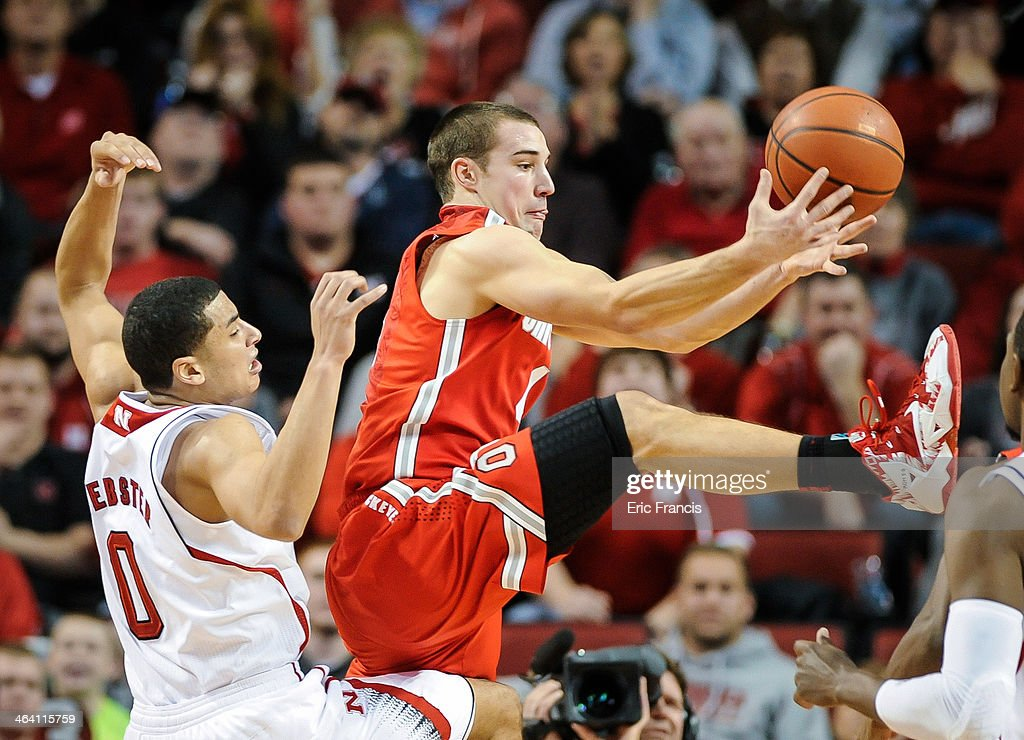 <a gi-track='captionPersonalityLinkClicked' href=/galleries/search?phrase=Aaron+Craft&family=editorial&specificpeople=7348782 ng-click='$event.stopPropagation()'>Aaron Craft</a> #4 of the Ohio State Buckeyes grabs a rebound over Tai Webster #0 of the Nebraska Cornhuskers during a game at Pinnacle Bank Arena on January 20, 2014 in Lincoln, Nebraska.