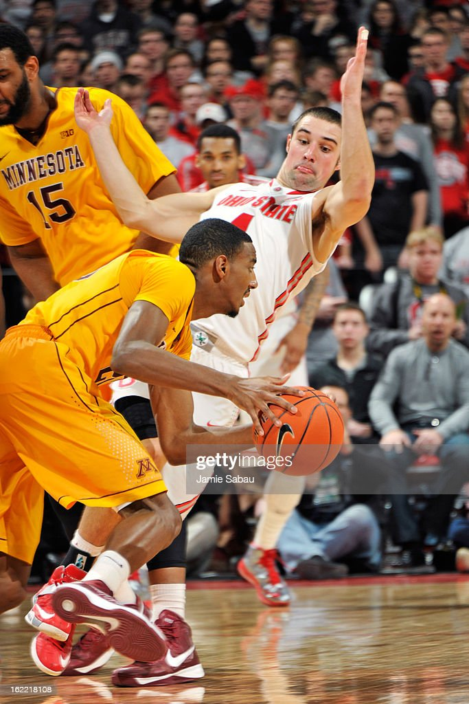 <a gi-track='captionPersonalityLinkClicked' href=/galleries/search?phrase=Aaron+Craft&family=editorial&specificpeople=7348782 ng-click='$event.stopPropagation()'>Aaron Craft</a> #4 of the Ohio State Buckeyes is fouled as he guards Austin Hollins #20 of the Minnesota Golden Gophers in the second half on February 20, 2013 at Value City Arena in Columbus, Ohio. Ohio State defeated Minnesota 71-45.