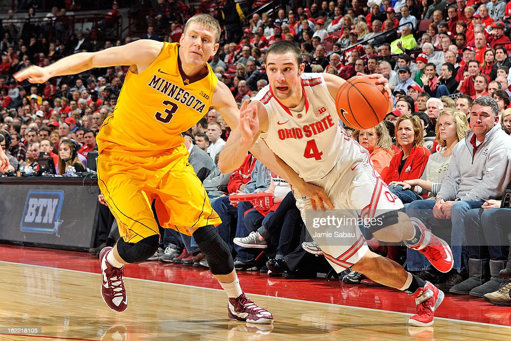 <a gi-track='captionPersonalityLinkClicked' href=/galleries/search?phrase=Aaron+Craft&family=editorial&specificpeople=7348782 ng-click='$event.stopPropagation()'>Aaron Craft</a> #4 of the Ohio State Buckeyes is fouled by Wally Ellenson #3 of the Minnesota Golden Gophers as he drives to the basket in the second half on February 20, 2013 at Value City Arena in Columbus, Ohio. Ohio State defeated Minnesota 71-45.