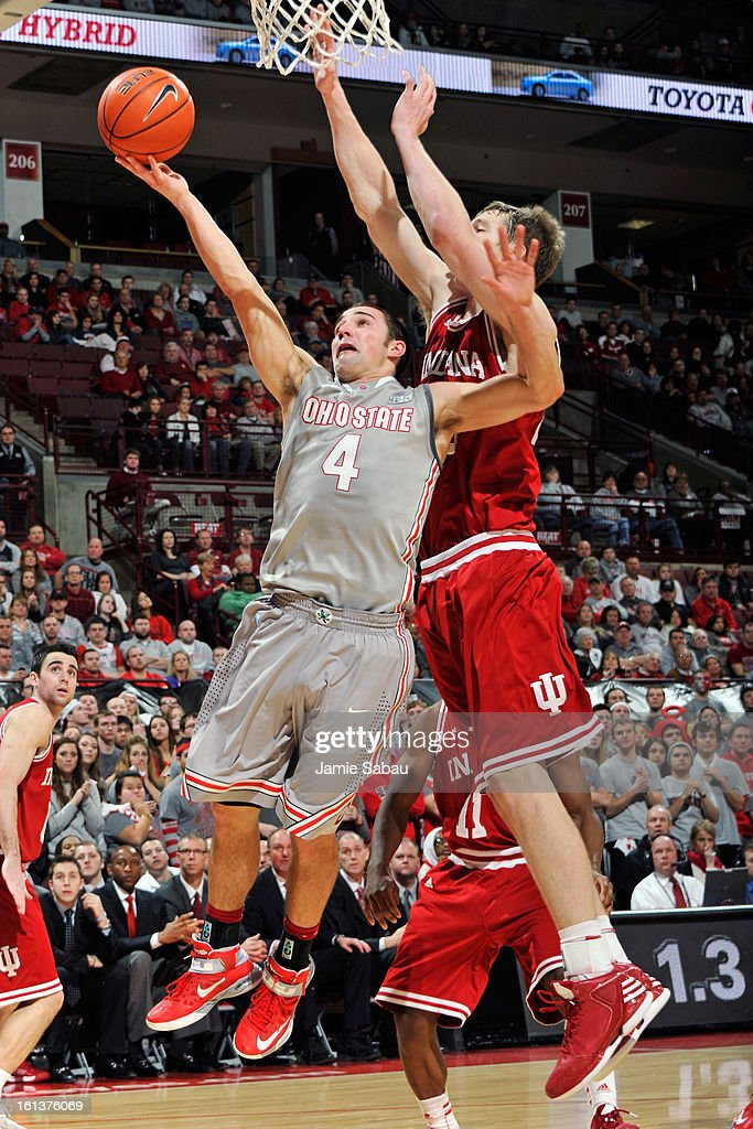 <a gi-track='captionPersonalityLinkClicked' href=/galleries/search?phrase=Aaron+Craft&family=editorial&specificpeople=7348782 ng-click='$event.stopPropagation()'>Aaron Craft</a> #4 of the Ohio State Buckeyes lays in the ball for two points past the defense of Cody Zeller #40 of the Indiana Hoosiers in the second half on February 10, 2013 at Value City Arena in Columbus, Ohio. Indiana defeated Ohio State 81-68.