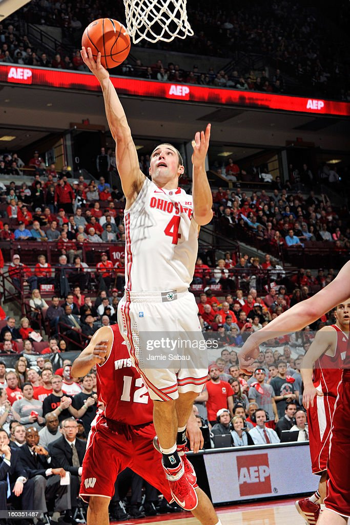 <a gi-track='captionPersonalityLinkClicked' href=/galleries/search?phrase=Aaron+Craft&family=editorial&specificpeople=7348782 ng-click='$event.stopPropagation()'>Aaron Craft</a> #4 of the Ohio State Buckeyes lays in two of his 13 points in the second half against the Wisconsin Badgers on January 29, 2013 at Value City Arena in Columbus, Ohio. Ohio State defeated Wisconsin 58-49.