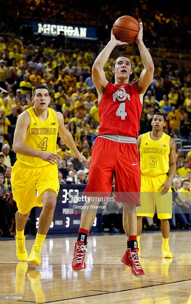 Aaron Craft #4 of the Ohio State Buckeyes looks to make a play against the Michigan Wolverines at Crisler Center on February 5, 2013 in Ann Arbor, Michigan. Michigan won the game 76-74 in overtime.