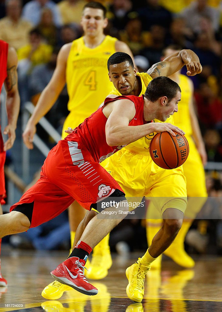 Aaron Craft #4 of the Ohio State Buckeyes looks to make a play against Trey Burke #3 of the Michigan Wolverines at Crisler Center on February 5, 2013 in Ann Arbor, Michigan. Michigan won the game 76-74 in overtime.