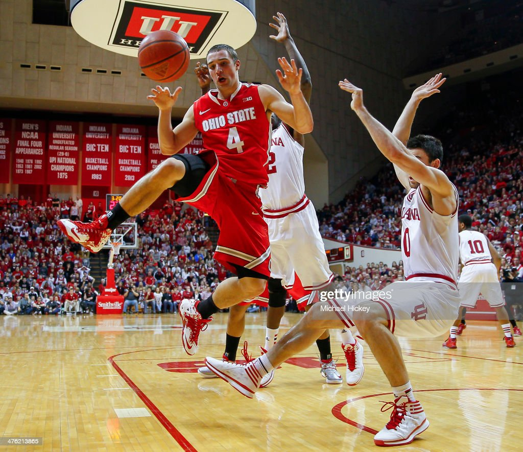 <a gi-track='captionPersonalityLinkClicked' href=/galleries/search?phrase=Aaron+Craft&family=editorial&specificpeople=7348782 ng-click='$event.stopPropagation()'>Aaron Craft</a> #4 of the Ohio State Buckeyes loses the ball while shooting as Will Sheehey #0 of the Indiana Hoosiers falls to the ground at Assembly Hall on March 2, 2014 in Bloomington, Indiana. Indiana defeated Ohio State 72-64.