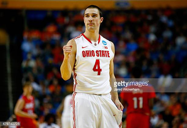 Aaron Craft of the Ohio State Buckeyes reacts against the Dayton Flyers during the second round of the 2014 NCAA Men's Basketball Tournament at the...