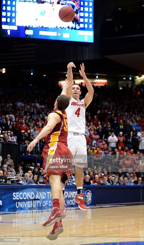 Aaron Craft #4 of the Ohio State Buckeyes shoots a game-winning three point basket against Georges Niang #31 of the Iowa State Cyclones late in the second half during the third round of the 2013 NCAA Men's Basketball Tournament at UD Arena on March 24, 2013 in Dayton, Ohio.